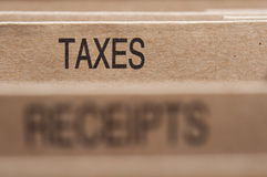 Taxes. Section tab in folding file Stock Image