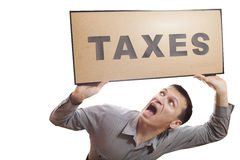 Taxes. Conceptual photography, humans have financial problems royalty free stock photography