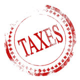 Taxes. Old red stamp with taxes written on it Stock Image