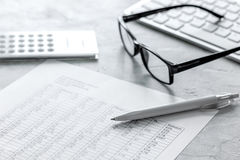 taxes accounting with calculator in office work space on stone desk background top view Stock Image