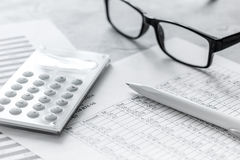 Taxes accounting with calculator in office work space on stone desk background top view. Business taxes accounting with calculator in office work space on stone Royalty Free Stock Photography