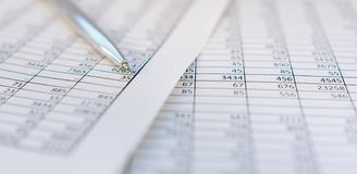 Taxes and accounting. Summary table. Pen and notebook on papers with calculations.. Taxes and accounting. Summary table. Pen and notebook on papers with royalty free stock photo