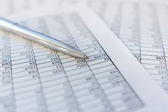 Taxes and accounting. Summary table. Pen and notebook on papers with calculations.. Taxes and accounting. Summary table. Pen and notebook on papers with royalty free stock image