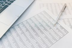 Taxes and accounting. Summary table. Pen and notebook on papers with calculations.. stock photos