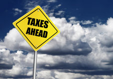 Taxes ahead sign Stock Photos