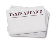 Taxes ahead title on a newspaper Stock Images