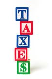 TAXES alphapbet blocks Stock Photo