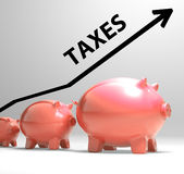 Taxes Arrow Shows Higher Taxation And Levies Stock Photo