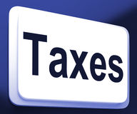 Taxes Button Shows  Tax Or Taxation Stock Photography