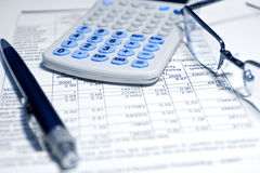Taxes calculator numbers pen and eyeglasses royalty free stock photos