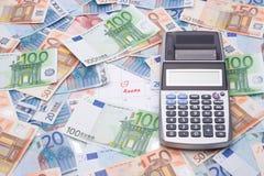 Taxes concept - money and calculator stock photo