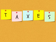 Taxes on Corkboard and sticky notes Stock Photo