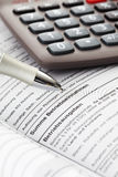 Taxes, costs, document, calculator, close up Stock Photo