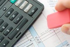Taxes: Erasing Incorrect Figures on Tax Form Stock Photo