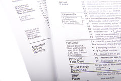 Taxes and Forms. U.S. Income Tax Forms on a white background stock photos