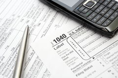 Taxes and forms, mobile phone and pen royalty free stock photo