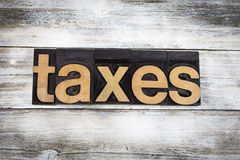 Taxes Letterpress Word on Wooden Background Stock Photo