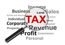 Taxes and Magnifying Glass Royalty Free Stock Image