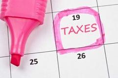 Taxes mark Royalty Free Stock Photo