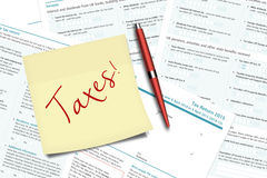Taxes note, pen and uk tax forms lying on  desk Royalty Free Stock Photography