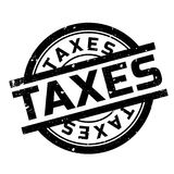 Taxes rubber stamp Royalty Free Stock Photos