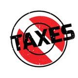 Taxes rubber stamp Stock Photos