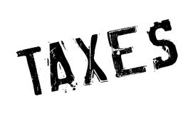 Taxes rubber stamp Stock Photography