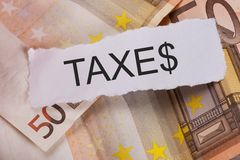 Taxes sign on euro banknotes Stock Image