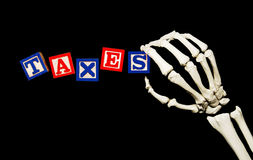 Taxes with skeletal hand Royalty Free Stock Photo