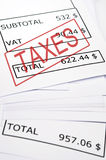 Taxes stamp on financial paper Stock Images