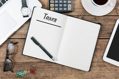 Taxes text, Office desk with computer technology, high angle Stock Photography