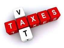 Taxes and VAT. Text 'taxes vat' in uppercase letters inscribed on small cubes and arranged crossword style with common letter 'a', white background Royalty Free Stock Photography