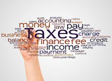 Taxes word cloud and hand with marker concept. On white background royalty free stock images