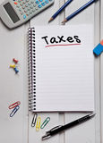 Taxes word on notebook Stock Images