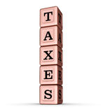 Taxes Word Sign. Vertical Stack of Rose Gold Metallic Toy Blocks Stock Images