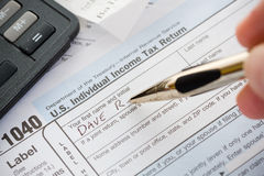 Taxes: Writing Name on 1040 Tax Return Royalty Free Stock Images