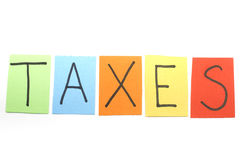 Taxes written in colorful letters Stock Image