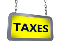 Taxes on billboard. Taxes on yellow light box billboard on white background Royalty Free Stock Photography