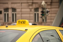 Taxi. Yellow taxi sign at downtown Prague Royalty Free Stock Photos
