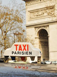 Taxi. Paris taxi detail and L'Arc de Triomphe in the background Stock Photo