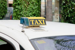 Taxi. Old taxi sign at aoutdoor Stock Images