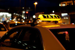 TAXI. Sing on a cab waiting on a stand stock photography