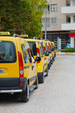 Taxi. Few yellow car taxi dispose in row Stock Images