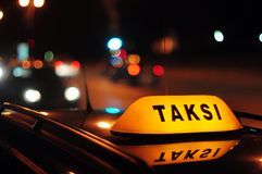 Taxi. Yellow TAKSI inscription with reflection Royalty Free Stock Image