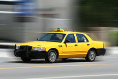 Taxi. Speeding to its destination stock images