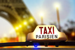 Taxi against the Eiffel tower Stock Photos