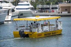 Taxi amarillo del agua Imagen de archivo libre de regalías