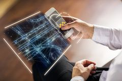 Taxi app and future concept. Side view of businessman hands using smartphone with abstract digital hologram for tracking taxi car on map. App, application and royalty free stock photography