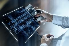 Taxi app and innovation concept. Side view of businessman hands using smartphone with abstract digital hologram for tracking taxi car on map. App and innovation Royalty Free Stock Photography