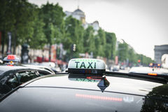Taxi At The Champs Elysees Stock Image